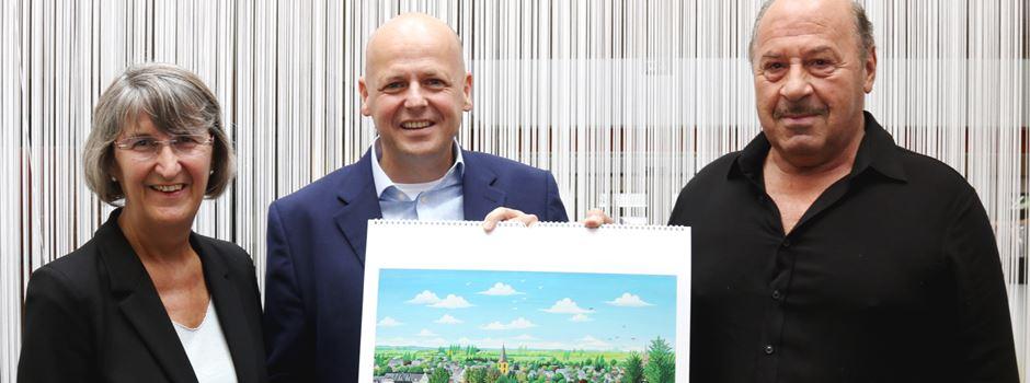 Josef Hawle signiert Kunstkalender für den guten Zweck